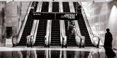 People rising on escalator